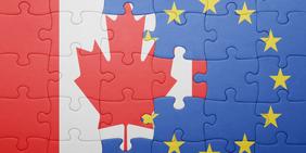 Fahnen von EU und Kanada als Puzzle